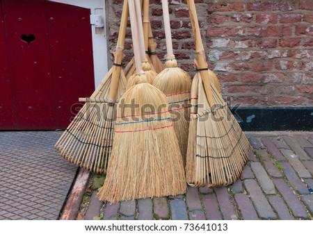 reed brooms for sale on a market in Deventer, Netherlands