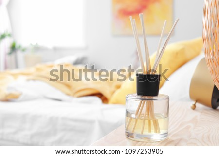 Reed freshener on table in bedroom #1097253905