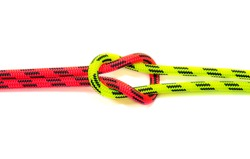 Reef, Hercules, square, double or brother hood Binding knot binding two colored red and green ropes. nautical loop used to secure rope or fishing line around an object. Isolated on white background