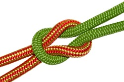 reef knot, yellow and green ropes. Isolated on white background.