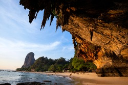 Reef Rock Beach Under the Large Cave of Phra Nang Cave in Krabi Province, Thailand ,This is a sunset time at Ao Tham Phra Nang Beach.