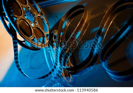 Reel of film on the blue background