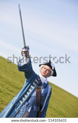 Reenactor in 18th century British army infantry officer uniform