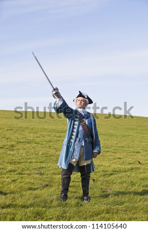Reenactor in 18th century British army infantry officer uniform