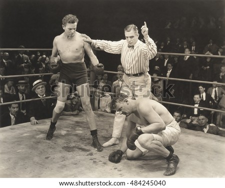 referee counting over boxer in...