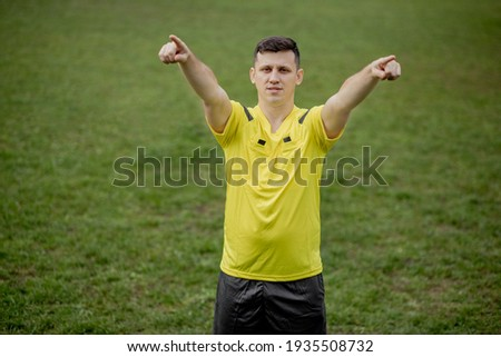 Referee goes watching VAR or violation of the rules. Concept of sport, rules violation, offside Stock fotó ©