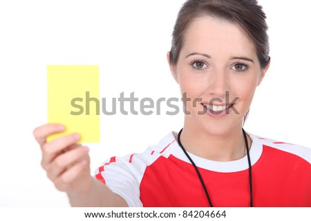 Referee holding up a yellow card