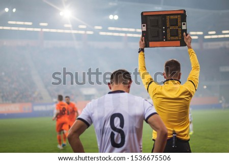 Referee shows players substitution during soccer match. ストックフォト ©