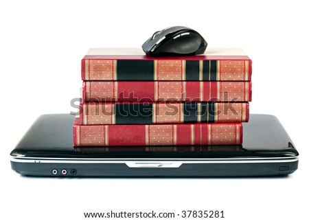 Reference books stacked on top of a laptop, with mouse.  On-line learning concept.  Isolated on white.