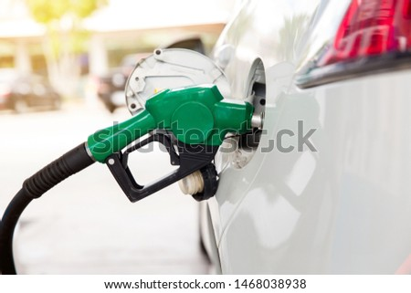 Refill and filling Oil Gas Fuel at station.Gas station - refueling.To fill the machine with fuel. Car fill with gasoline at a gas station. Gas station pump.  #1468038938