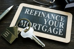 Refinance your mortgage word on the small blackboard.