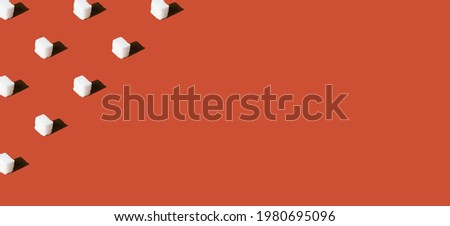 Refined sugar on a red background.  Place for text. Concept of healthy eating and diabetes prevention Stock photo ©