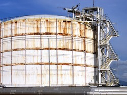 Refinery crude oil storage tanks at large, with the old rust and corrosion from the session.