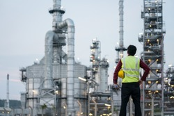 Refinery industry engineer wearing PPE Working at refinery construction site