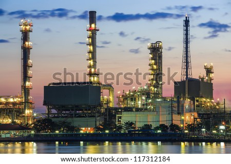 Refinery plant area at twilight with reflection in river