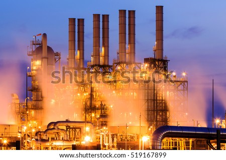 Refinery tower in petrochemical industrial plant with Twilight