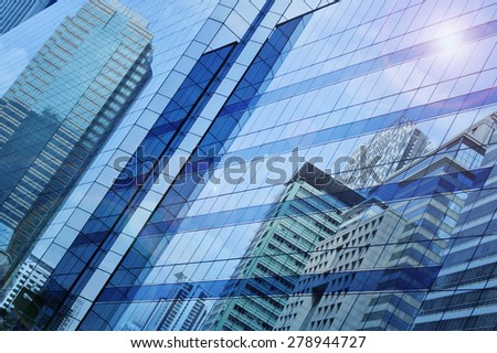 Reflect of modern city building on window glass tower, blue tone, Bangkok Thailand #278944727