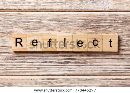 Reflect word written on wood block. Reflect text on table, concept. Stock foto ©