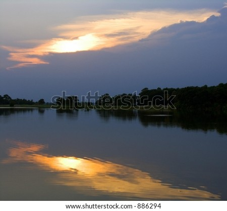 Reflected Sunset Over Pond