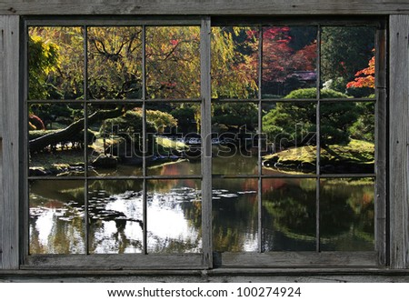 Reflecting pond with lilly pads, a small island, and fall colors in the background, all viewed through a vintage, wood framed,divided light window./ Japanese Garden Through the Window/ Great view