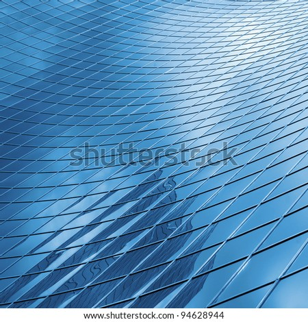reflecting sky in glass of office  building ; abstract  background