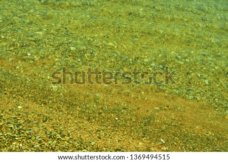 Reflection and refraction on the surface of the water. Abstract background.