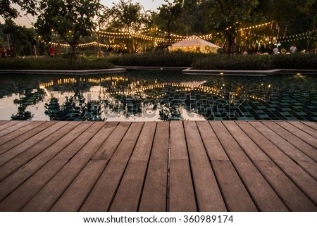 reflection background of camping party with pool at evening time with natural light