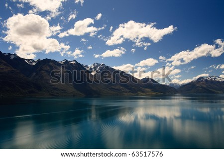 Reflection from Lake Wakatipu surrounded by mountains near Queenstown, South Island, New Zealand