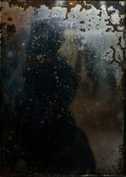 Reflection in old dark mirror. Antique, vintage, texture. Abstract image, background.