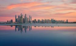 Reflection in the hotel pool of Dubai Marina Skyline at sunset