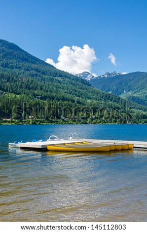 Reflection in water of mountain lakes and boats. Alta lake in Whistler, Vancouver, Canada. Beauty world.