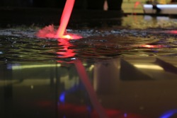 Reflection in Water. Red Light. Shopping Center. Pool.