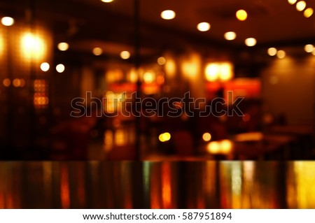 reflection light on table in bar and pub at night background
