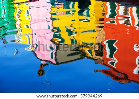 Stock Photo Reflection of a colorful houses in water canal, Burano island, Venice, Veneto region, Italy
