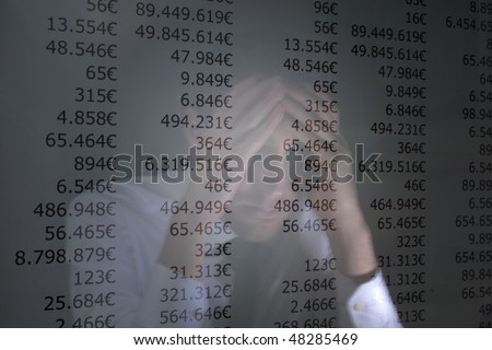 reflection of a despaired man on a monitor display outstanding amounts