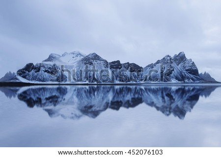 Reflection of a Mountain in Iceland on a north atlantic ocean bay.