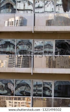 Reflection of a skyscraper in the facade of a skyscraper (Dubai UAE) #1321498502