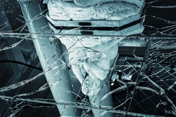 Reflection of a statue in broken glass, horror
