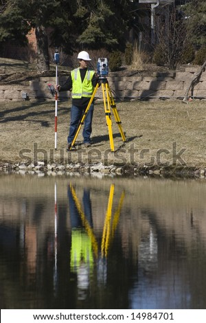 Reflection of a Surveyor working with robotic station