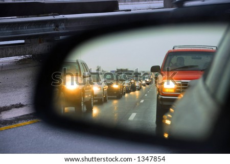 Reflection of a traffic jam in a sideview mirror