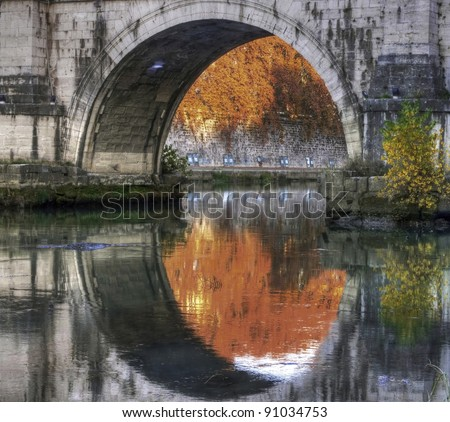 Reflection of an arch of a bridge, Rome, Italy
