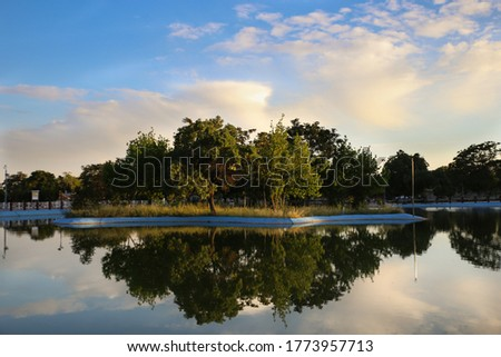 reflection of an artificial island on an artificial lake