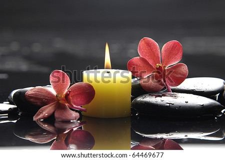 Reflection of aromatic candles and orchid flower for spa objects