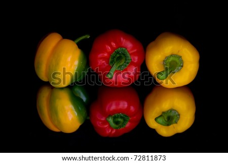 Reflection of bell peppers - stock photo