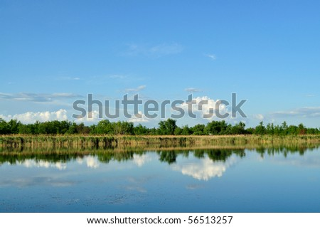 Reflection of blue sky with clouds in the lake