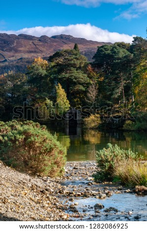 Reflection of boathouse on Derwent Water, Lake District, Cumbria #1282086925