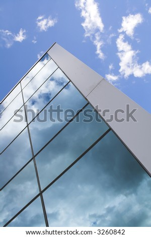 reflection of clouds an office building