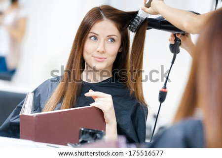 Reflection Of Hairdresser Doing Hair Style For Woman In Hairdresser\'S. Concept Of Fashion And Beauty