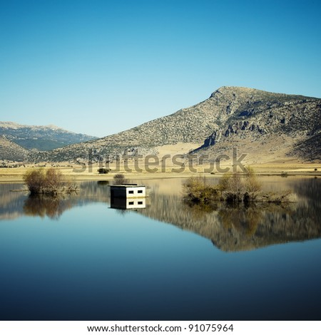 Reflection of hills, trees and house in lake , Antalya ( Grain Added )