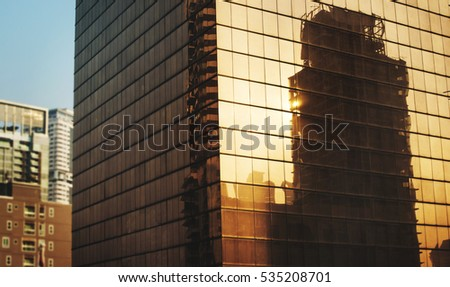 Reflection of industrial construction on building #535208701